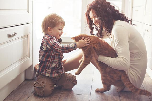 Mother and her son holding cat