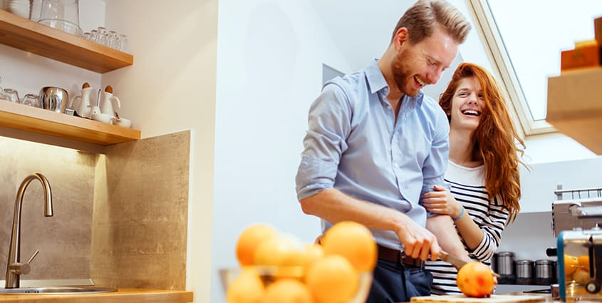Couple in apartment kitchen