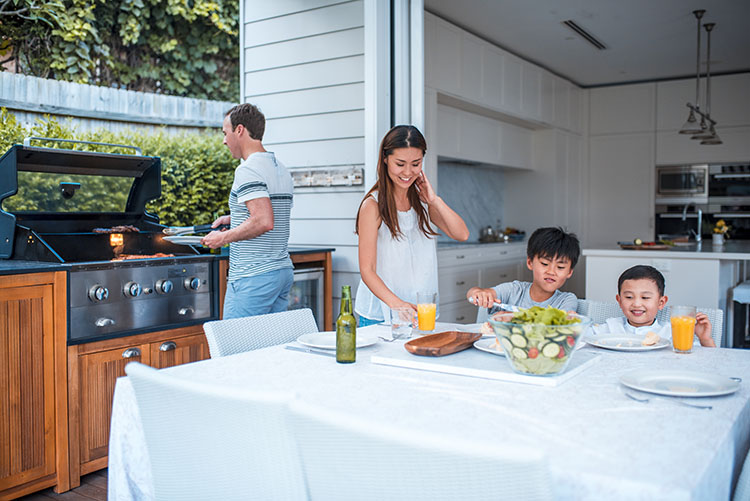 Family grilling outside