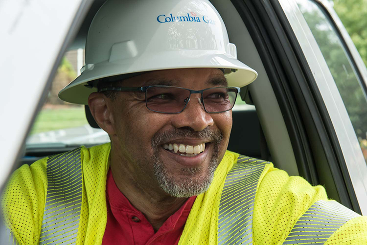 Columbia Gas field employee smiling