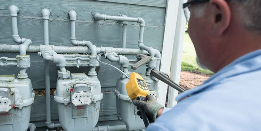 Employee working with gas meters