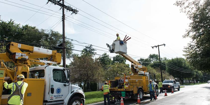 Employees restoring power for customers