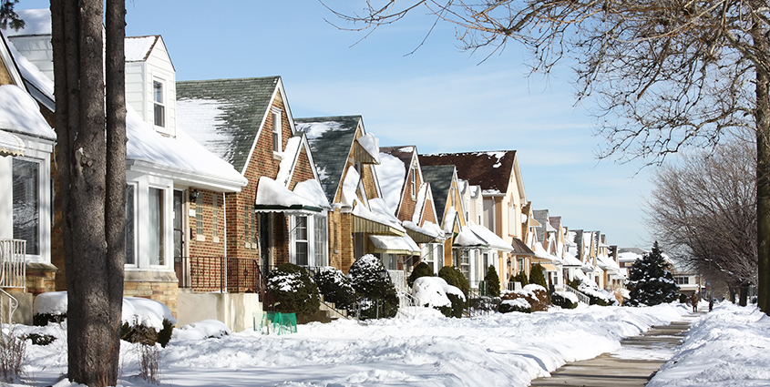 Row of brick houses cover in snow