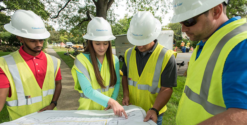 Field employees reviewing map